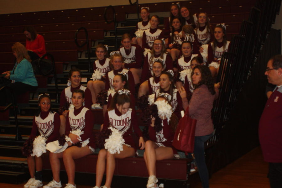 Team spirit!  The cheerleaders watch as the two teams shake hands.  They cheered the entire match being lead by their team captins.  The cheer captins are Hailey Ratchford, Caleigh Rudy and Ella Strawmeir