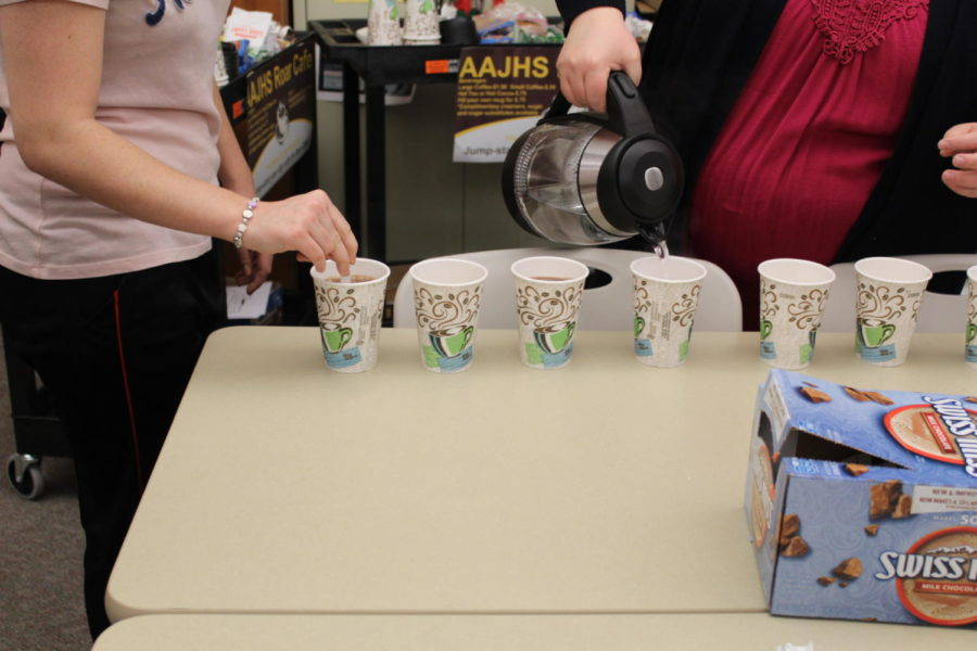 Keep stirring! Life skills students pouring and stirring the hot chocolate for the teachers that ordered. They worked very officently.