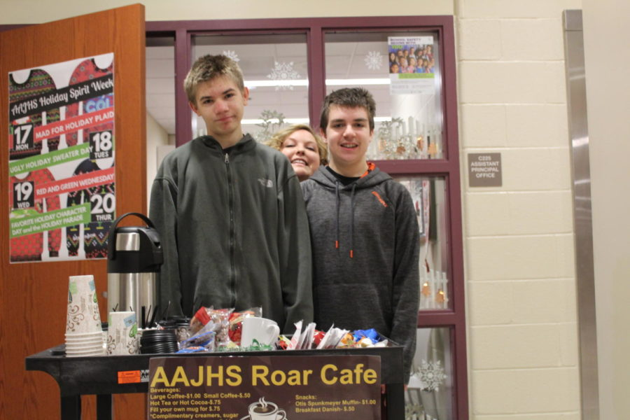 Say cheese! Mrs.Arthur gets Milton Hillard and Ethan Bailey to smile for the camera. They got to wheel around the coffee cart!