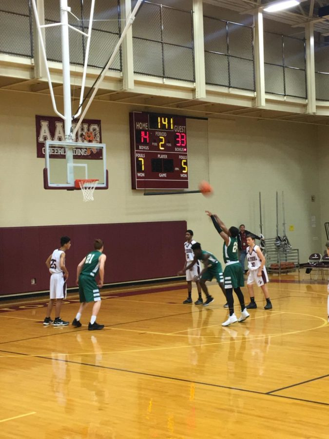 Player from Central Dauphin takes a foul shot.  Followed by many more.