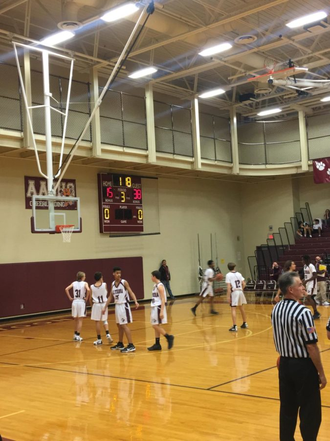 The ninth grade boys' maroon basketball game warm up before the third quarter.  On Monday, the maroon team vs Central Dolphin.