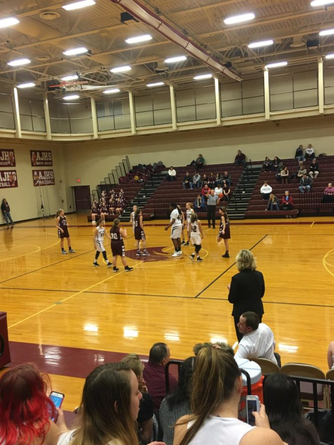 The players are getting ready to start of the game.Both maroon and white girls' basketball had a game Tuesday.