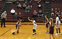 Eighth grader Taylor Lane takes a shot. She made many more shots for the team.