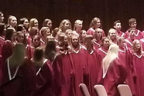"The vocal ensemble is beginning to line up on stage.  The chorus were preparing to perform their first song,  ""Aurora Borealis."""