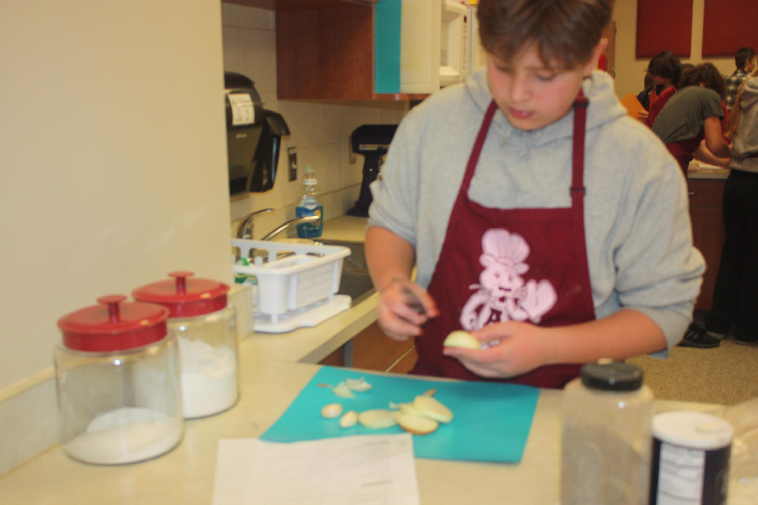 Cut it up!  Landen Hauser cuts an onion up to add in his meal. Foods class lasted for a semester.