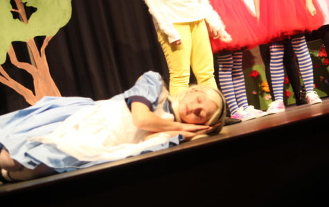 Sleepy! Parker Cook lies on a field of flowers and falls asleep.  The junior high drama club participated in an