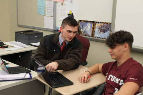 Good teaching! Eighth grade teacher, Cameron Kyle helps his student Tysen Larocco with a Chromebook problem. Kyle worked as an in-school teacher last year.  This is his first year teaching eighth grade.