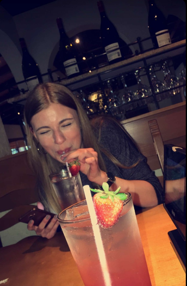 Jenna Williams drinks a strawberry lemonade while at Olive Garden.