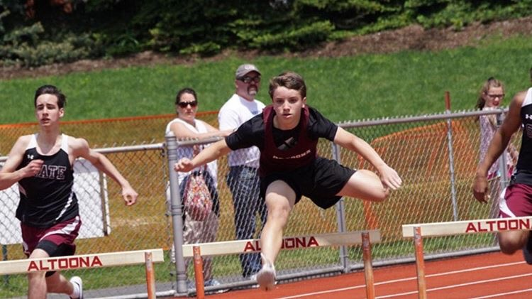 Eighth+grader+Tyson+Reid+runs+the+300+meter+hurdles.The+boys%27+track+team+won+championships.