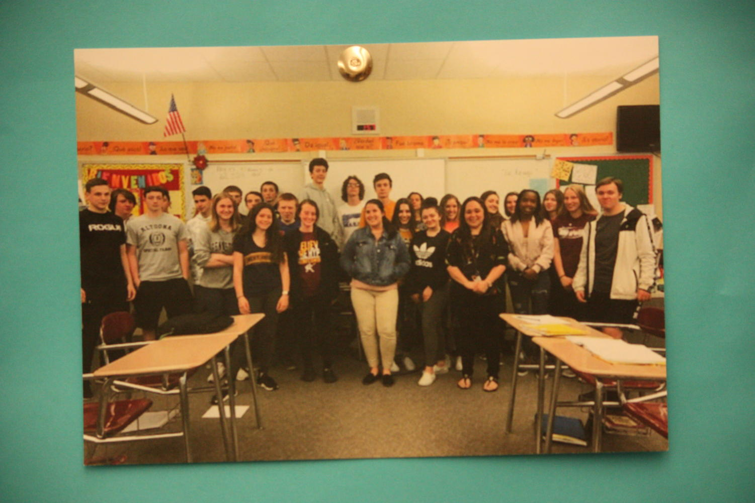 Adios amigos!  Student teacher Willa Boothe says goodbye to her last class on her last day. Spanish teacher Patricia Leonard and Boothe took a group picture with each class.