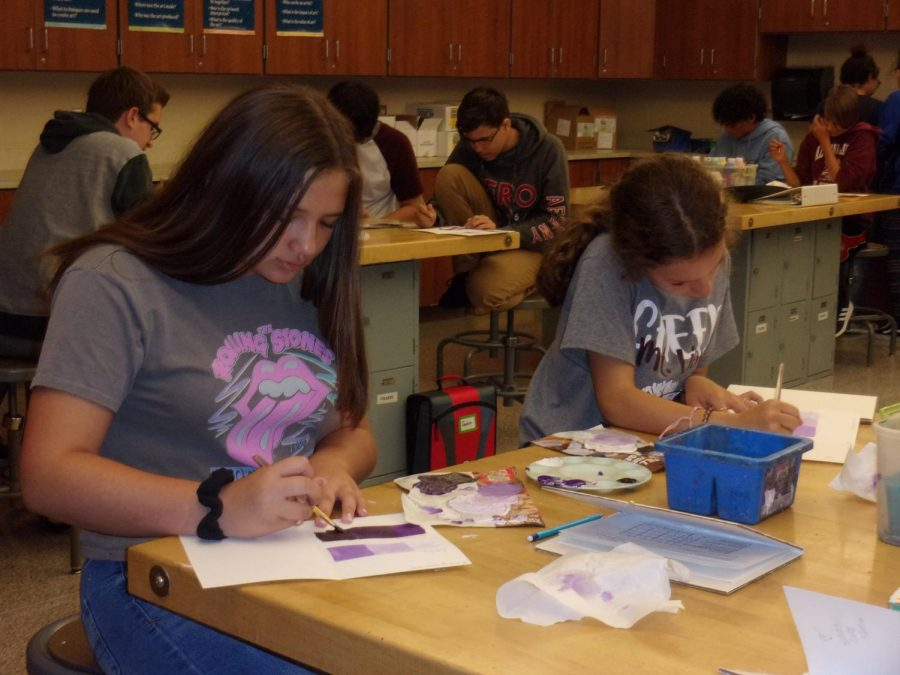 Art Class  On Sept. 5th, Kelly Terrebonne and Zoey Dunkle are painting their assignments on tints and shades in Mr. John King's art classroom.