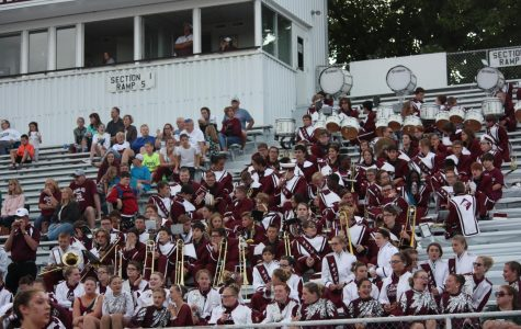 """Fun in the stands! The Altoona Band and Band Fronts cheer on the mountain lion team. They do stand cheers such as George, Chaser,and Nae Nae. """"When we are in the stands I feel that we truly become a family in the fact that we support our jr. high football players,"""" drum major, Jacob Steinbugl said."""