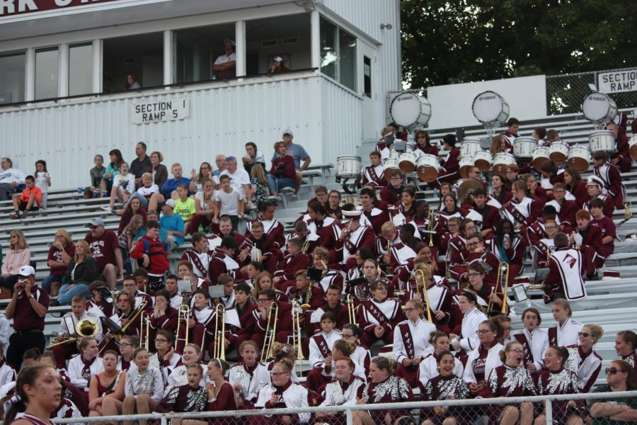 "Fun in the stands! The Altoona Band and Band Fronts cheer on the mountain lion team. They do stand cheers such as George, Chaser,and Nae Nae. ""When we are in the stands I feel that we truly become a family in the fact that we support our jr. high football players,"" drum major, Jacob Steinbugl said."
