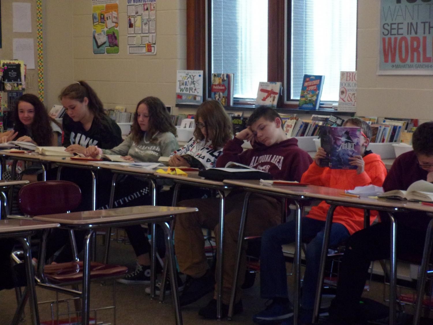 Seventh Grade ELA Classroom Seventh grade students read during their fourth period ELA class. The students  worked together to complete an assignment during the 90 minute period.