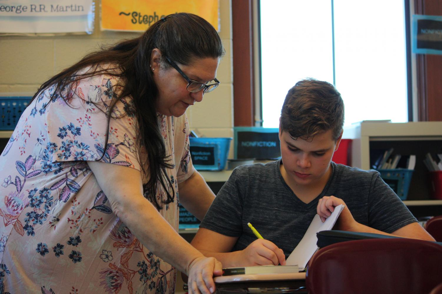 Read All About It!  Heidi Bardelang encourages, eighth grader, Anthony Jablonski with his book. Jablonski has been participating in reading workshop.