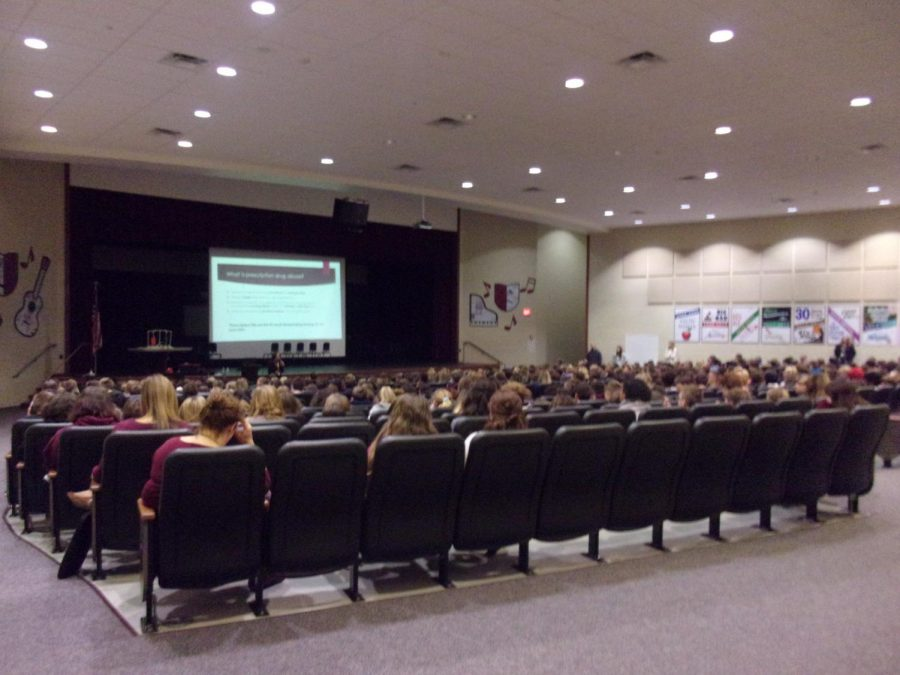 Students+listen+to+Marissa+Hewitt+as+she+informs+them+about+teen+usage+of+drugs+and+alcohol.+Hewitt+talked+about+the+dangers+and+what+could+happen+if+teens+start+to+use+illegal+substances.