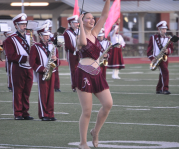 Marching along! On Oct. 24, Danielle Bardelang marches down the field in her feature costume. Danielle is the majorette captain and had the opportunity to be a soloist at her last game.