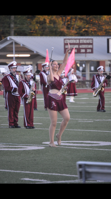 Marching+along%21+On+Oct.+24%2C+Danielle+Bardelang+marches+down+the+field+in+her+feature+costume.+Danielle+is+the+majorette+captain+and+had+the+opportunity+to+be+a+soloist+at+her+last+game.