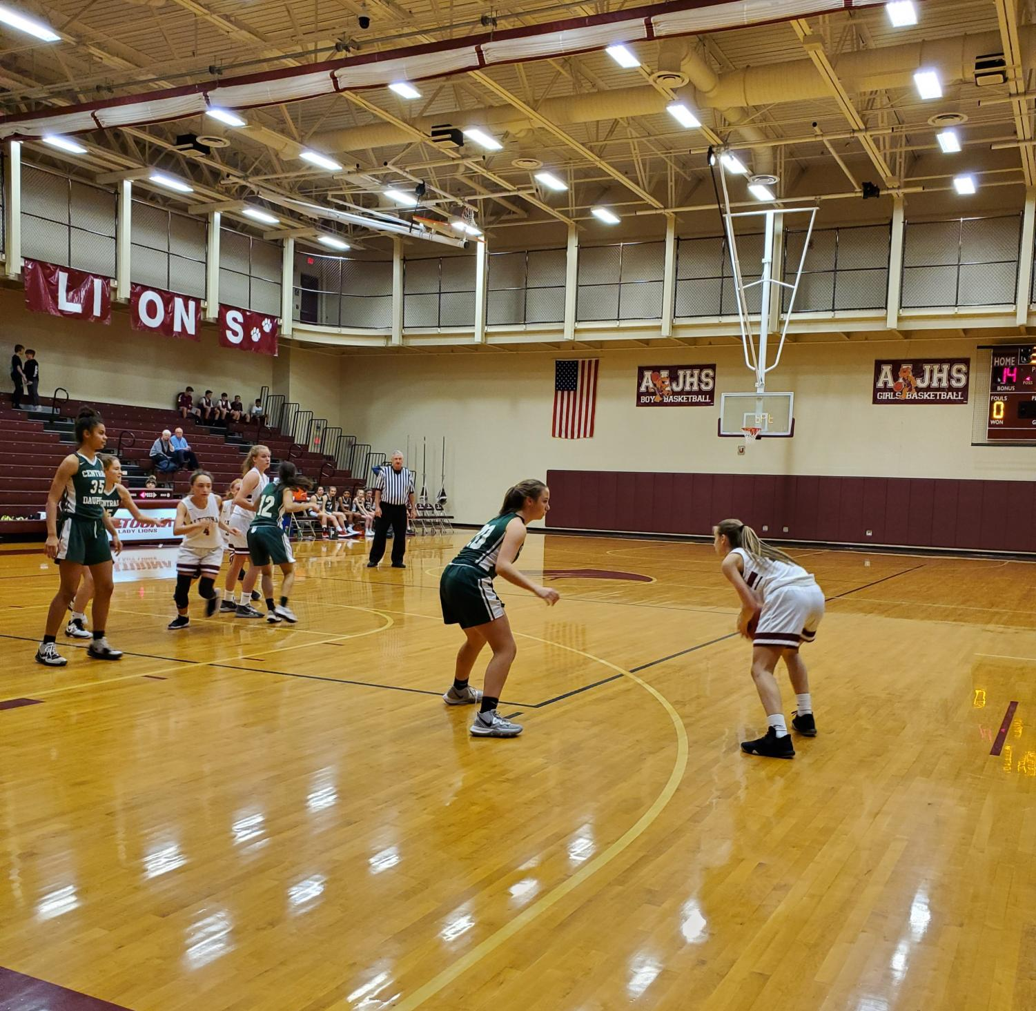 Shoot it! Eighth grader Kaylee Harpster plays offense in her basketball game on Dec. 16. The teams works together to beat their opponents.