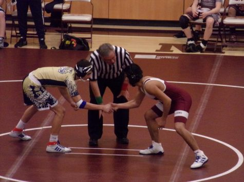 Rivalry Pablo Rojas faces off against a Hollidaysburg opponent.  The referee signaled for the match to begin.