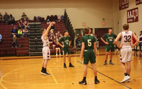 Score! Sean Bettwy is ready to make a foul shot. Making the shot, he helped his team in the second half of the game.