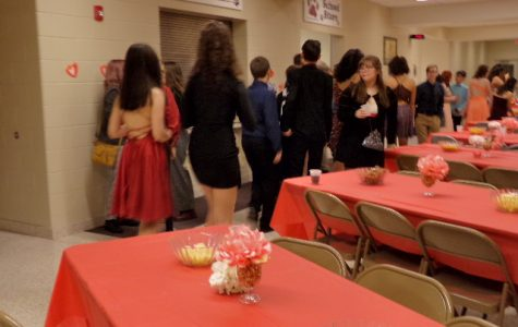 Get ready to dance. Eighth grade students get snacks at their dance. The eighth graders at Sweethearts danced and socialized with their friends.