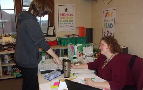Betsy Cron shares information about a reading workshop assignment. She has been teaching the curriculum since Jan. 13.