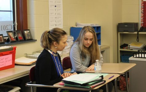 Look It Over Rebeccah Anderson, a high school counselor, works with ninth grade student  Catalina Musser to complete her schedule. Ninth grade students at the junior high are completing their scheduling for this month during their math periods with the help of counselors.