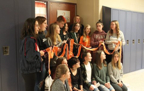 Rachel's Club members cut the ribbon to officially open Rachel's Closet. Students and teachers have been setting up the in-school store.