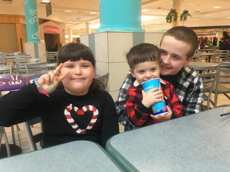 Henry Lohsl and his two siblings pose for a picture at the Logan Valley Mall. Henry remembers when he was able to get out of the house and share time with his siblings.