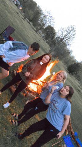 On Friday May 22, ninth graders Kristina Lepore, Peyton Daniel, Kadence Zerbey and Connor Lindsey celebrate going into the yellow phase by having a fire. This was the first time they have hung out since the lockdown was put in place.