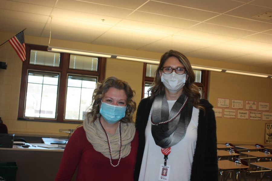 Staying+Safe.+Mrs.Lewis+and+Mrs.Kozak+were+keeping+there+masks+on+while+teaching+their+Group+A+students+on+a+hybrid+school+day.+These+teachers+displayed+their+school+spirit+too+wearing+maroon+and+white%21