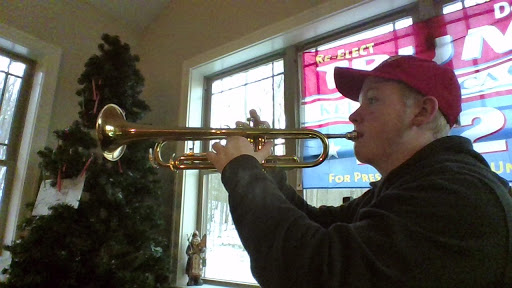 Playing position. Eighth grader, Randy Grove, played the trumpet on Dec. 1, 2020. His playing was part of his audition for this year's AAJHS jazz band.
