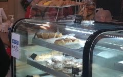 This case displays multiple items available at Piekarnia Bakery for purchase.