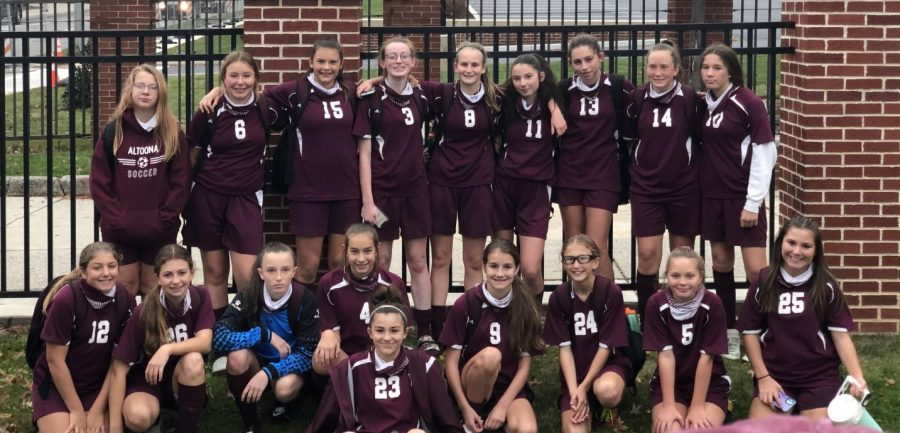 Team effort. This photo was taken after the Altoona seventh and eighth grade girls soccer team played their last game of the season.  They played Bedford and won 6-0.