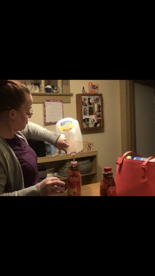 Desiree Kearney prepares her iced teas for her trip to the grocery store.