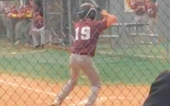 Batter up! Colton Anderson, outfielder, is up to bat. Anderson was able to hit a single making his team erupt in cheers!