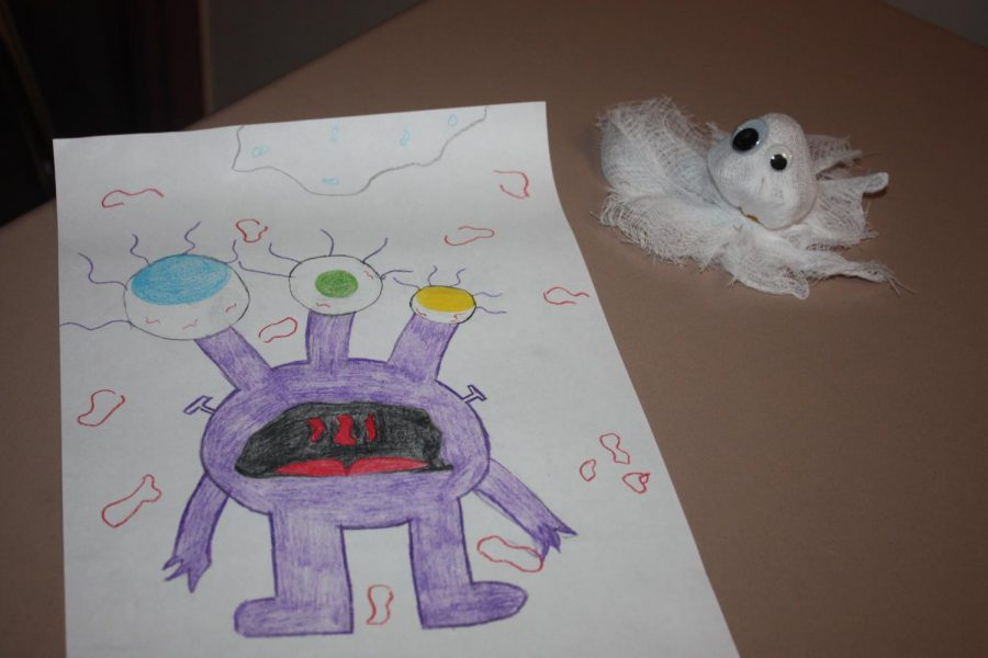 Eye catching! This creative drawing depicts a purple alien with one big eye that collects more sunlight in order to survive on its destined planet. This tiny creature is very small in order to run or glide around on its own planet safely.