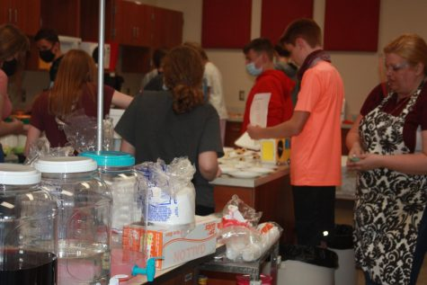 Chefs, set, cook!! Eighth graders start to set up for the annual food truck challenge. This challenge was held in Brandy Juart
