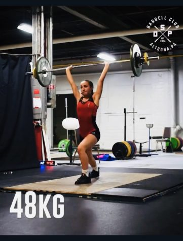 Pull, squat, jerk! Gracie Rice performs her final clean and jerk attempt at Youth Nationals. Freddie, the coach, also Rice's uncle, encouraged her to try Olympic Weightlifting, which she eventually did and really enjoyed it.