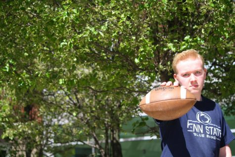 Go long! Randy Grove, lineman for the football team, poses with his favorite item, a football. Grove cannot wait for the season to come around again and for his high school football career to begin.