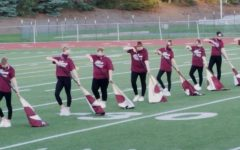 """Silks, position! This year's silks perform their routine for the """"Star Spangled Banner. The girls trained all summer and finally showcased their skills for the crowd at this year's marching band showcase October 16, 2020."""
