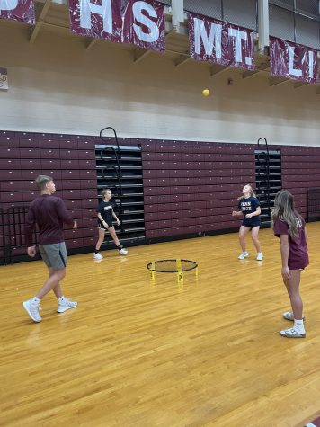 Competitive fun! Mark Harrington, Ava Steinbugl, Rowan DiSabato and Ellaina Saylor take part in a game of competitive spike ball. The game began right before the teachers called everyone into the other gym to announce the winners of the raffle baskets.